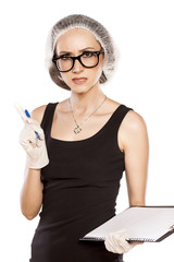Talking angry woman with a pen, protective cap and gloves