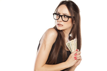 stingy beautiful woman holding her money