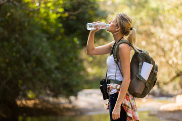young hiker drinking water