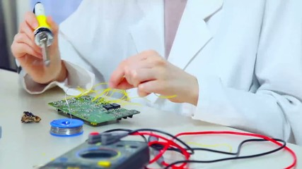 girl student soldered electronic components