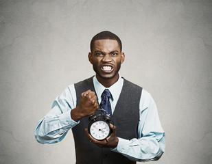 Portrait demanding corporate boss holding clock screaming
