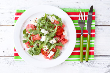 Salad with watermelon,tomatoes,  feta, arugula and basil leaves