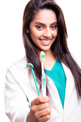 Dentist doctor holding brush and mirror