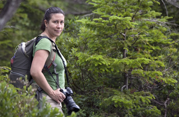 Female photographer in the woods