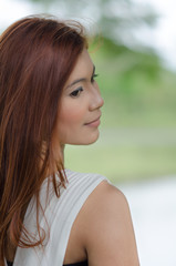 Attractive young redhead Asian woman