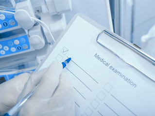 Medical examination. Doctor with a checklist on clipboard in the