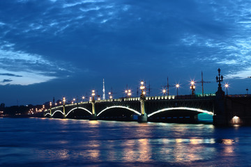 Night view of the Neva River and the old bridge