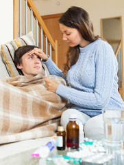 Woman caring for sick man
