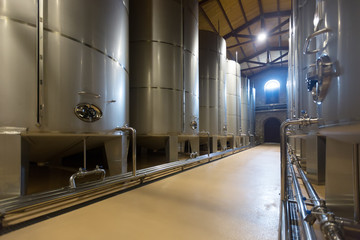 large stell barrels in winery
