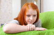 Red-haired unhappy teenager girl
