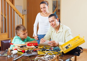 Ordinary family with working tools