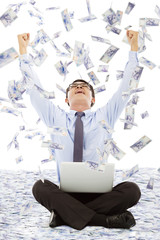 business man making a successful pose with money rain background