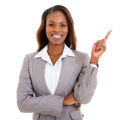 african businesswoman pointing empty space