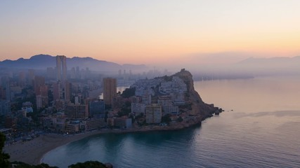 A foggy sunrise over  Mediterranean resort Benidorm