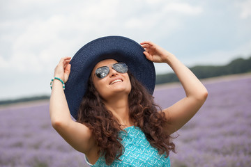 Beautiful girl with hat, smiling on the lavender field