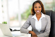 young afro american businesswoman sitting in office - 67902901