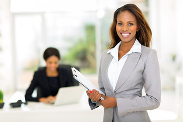 african businesswoman holding clipboard
