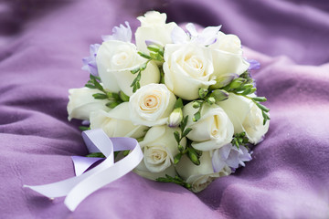 Wedding bouquet with white roses on violet background