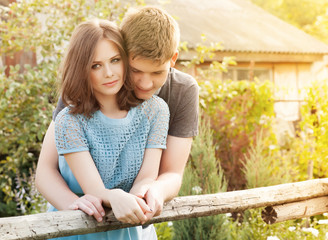 Pretty summer sunny outdoor portrait of young stylish couple
