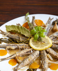 Tasty Marinated sardines on white plate with Mediterranean
