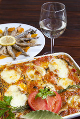 Melanzane alla Parmigiana and Marinated sardines in background