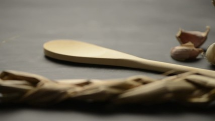 Wooden spoon and garlic