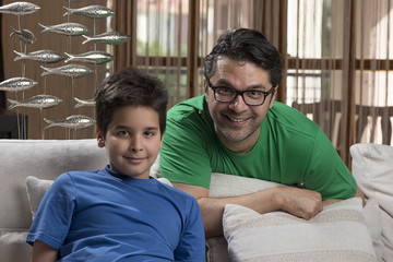 Cheerful Father and Son at Home