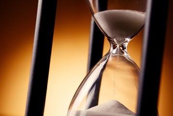 Sand running through an egg timer or hourglass