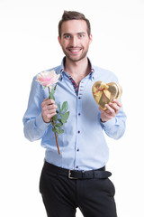Young happy man with a rose and a gift.