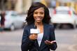 Leinwanddruck Bild - african female news reporter in live broadcasting