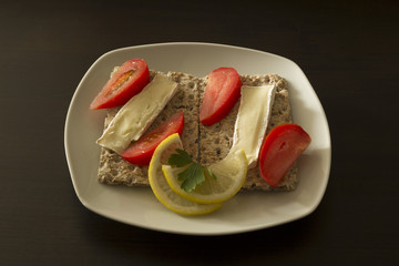 Whole wheat bread with cheese and tomatoes