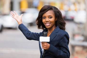 african news reporter in live broadcasting on street