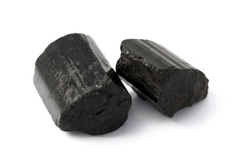 Black tourmaline raw rocks on the white background.