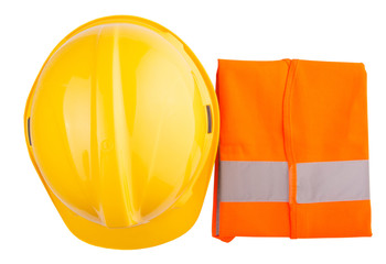 Yellow hard hat and orange reflective vest over white background