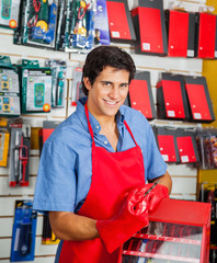 Salesman With Drill Bit And Toolbox In Shop