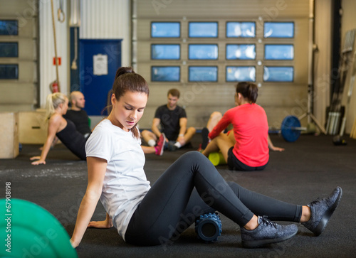 canvas print picture Woman Doing Relaxation Exercise In Crossfit Gym