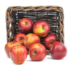 Apples on the background of an old basket