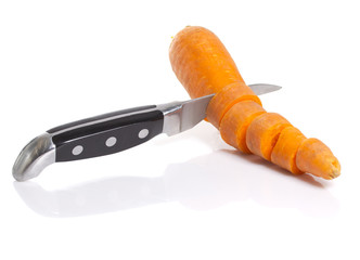 Sliced carrot with knife isolated on white background
