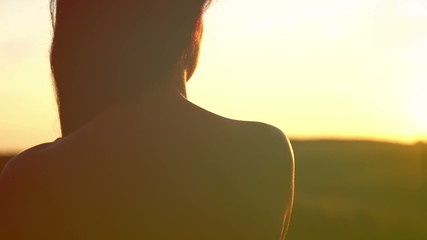 Portrait,silhouette of a girl from the back on sunset.