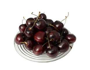 Plate of fresh delicious Cherries on a white background