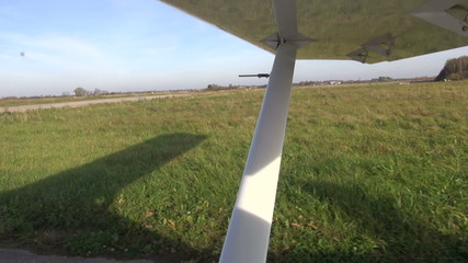 small airplane aircraft wing on rural airfield