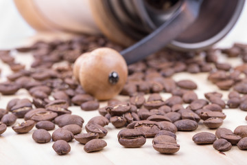 Coffee beans on the background of a coffee grinder
