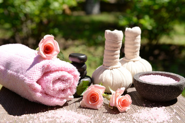 Herbal remedies for massage on table, outdoor