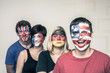 Funny people with painted flags on faces