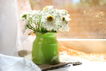 Beautiful flowers in home interior decoration
