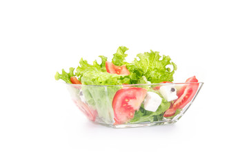 Salat with tomato and cheese in a bowl