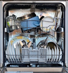 Open the front door of the dishwasher full of clean dishes.