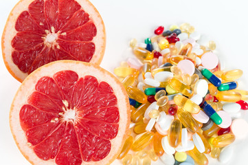 grapefruit and pills, vitamin supplements, healthy diet concept