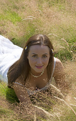 Young woman laying down in the grass