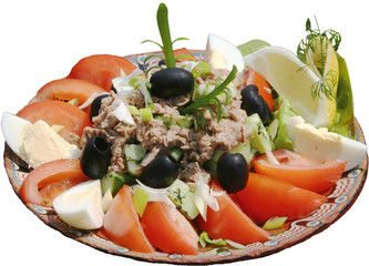 Bowl of Traditional tuna Salad with tomatoes, eggs and olives